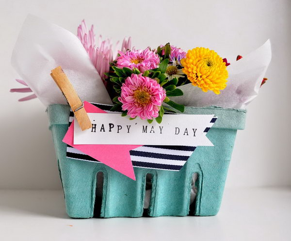 Berry Basket May Bouquet. Line each basket with a sheet of parchment and nestled in mason jars. Fill the mason jars with flower and water. Pin a few embellishments to finish off the beautiful outlook for May.