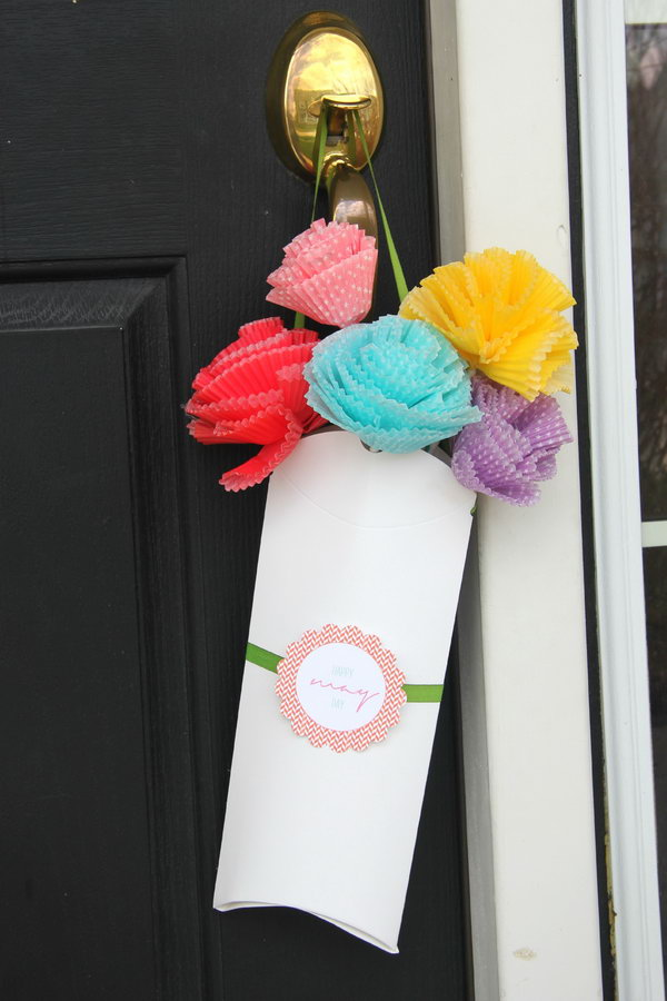 Pillow Box Bouquet for May. Make colorful flowers in various sizes from the cupcake liner and glue to the straw. String ribbon through the punch holes, add the tag and slide the flowers into the box to catch everyone's attention with this beautiful bouquet in May.