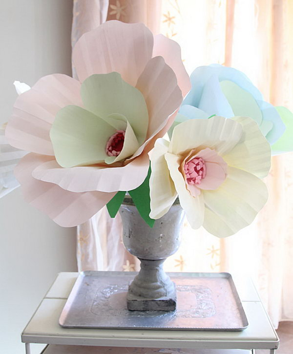 Giant Paper Flower Bouquet Centerpiece. Cut slits in petals by tracing the template and assemble them together to form a cup shape. Arrange and glue petals together. Glue flower and leaves to the dowel. Everyone will enjoy this brilliant piece of art in May.