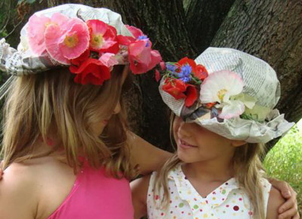 Floral Hat. Place sheets of newspaper over head and mold to shape. Tape around the head, add flowers and tape in place. Roll brim at the forehead to finish off this gorgeous floral hat.