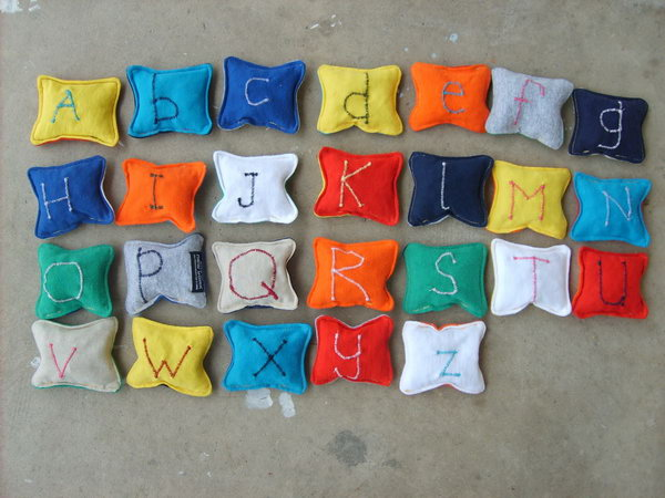 Recycled T shirt Alphabet Beanbags. Make these fun and colorful alphabet beanbags by using old T shirt. Your little ones will love them very much, and it will also be easier and more fun to learn 26 letters for your kids.