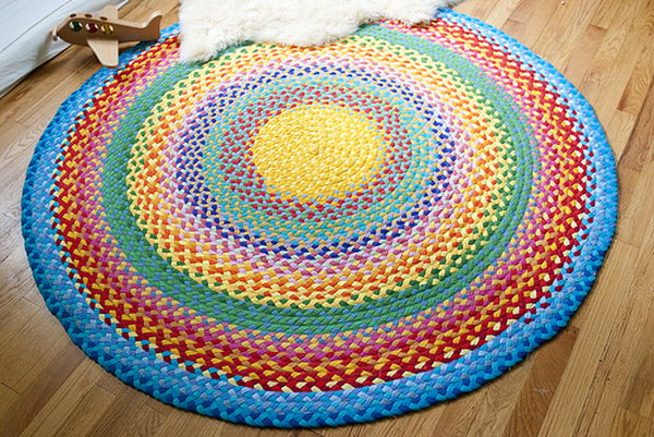 Braided Rainbow Rug with Old T shirt. This braided rainbow rug looks great in the play room.but it is not an easy project.If you have enough time and patience, you can have a try.