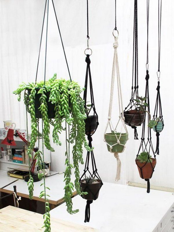 T-shirt Plant Hanger. This is a really simple DIY project for any crafter  - all you need to be able to do is to twist and knot t-shirt strips to make these cute hanging planters. Add your flower pot into the center - pot a flower or plant - hang on your deck or in your bedroom - and enjoy!