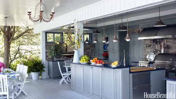 Plain and fancy cabinets with Nantucket-style doors and blue-toned Caesar stone on top plus the colors of water. It is a great place for cooking and holding a party during summer.