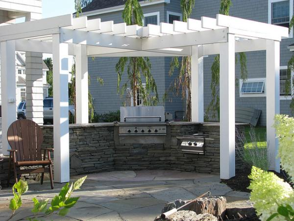 This outdoor kitchen takes its colors from the earth and the sky. It is about being friendly with nature. Looking simple but equipped with everything you need for cooking. It's fully functional.