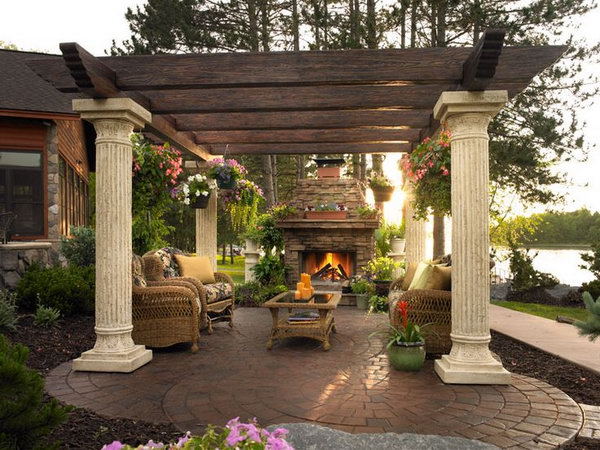 The traditional brick fireplace and the pergola made from wood are really nature-friendly. It's not only a cooking place but also a nice comfortable seating area.
