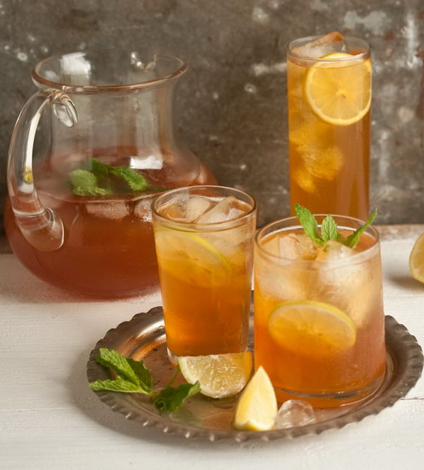 Home made Ice Tea with Ginger, Mint and Lemon. This affordable  and tasty summer drink  is super easy to make at home.  Brew a strong jug of tea and keep it  in the fridge after its cooled, then pour it over a glass filled with ice to dilute it and cool it down even further.