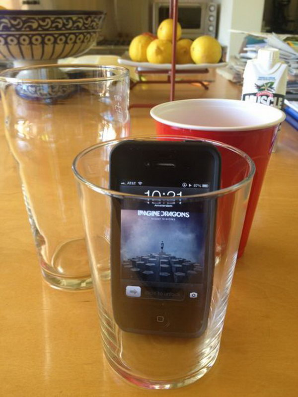 Glass iPhone Speaker: Put your phone in a glass to make the music loud enough to fill the room. So simple and clever way. See the tutorial