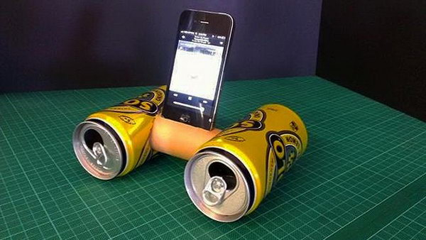 Recycled Trash Cans and Toilet Paper Roll iPhone Speaker: This little thing was made out of two drink cans and a toilet roll and it's really easy to recreate. Cut a hole in the sides of two soft drink cans big enough for a toilet roll to fit into. Cut a hole in the side of the toilet roll, secure it between the two cans. You will get a amplifier give your music extra volume and a crisper, cleaner sound.