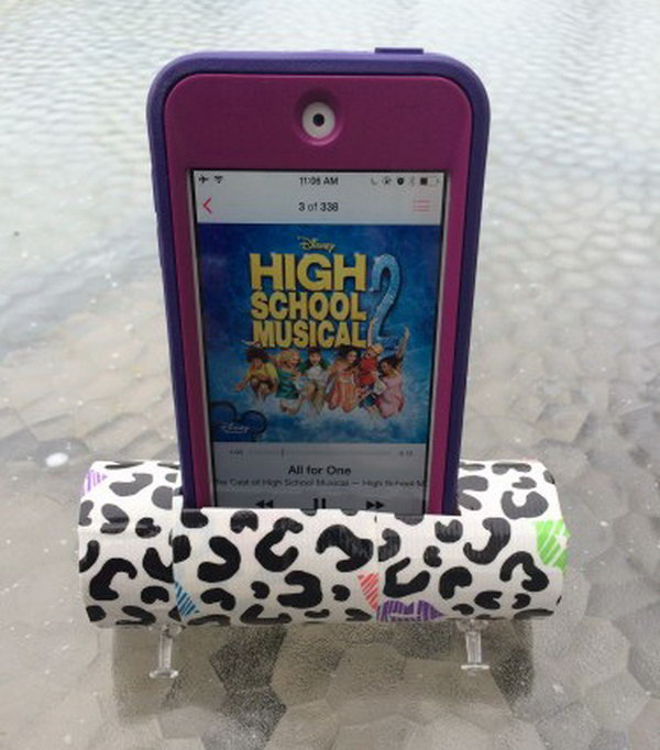 DIY Toilet Paper Roll iPhone or iPod Speaker Stand: To make this extremely simple version. You need to use an empty toilet paper roll and two pushpins! This speaker is pretty weak, but it really improves the quality and volume of the sound compared to the regular phone speaker. See the tutorial