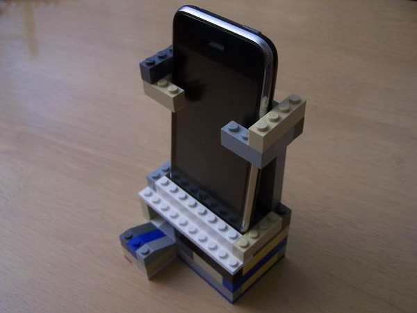 Lego iPhone Speaker Stand : This electricity-free Lego iPhone speaker amplifies the sound a little, but it's main purpose is to direct the sound in a more specific direction rather than all over the place like it usually does. And it's also a great iPhone stand. See the tutorial