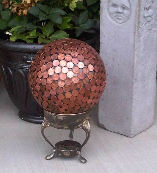 Penny Gazing Ball Yard Art.   Add year-round color to your garden with  fabulous art projects you can make yourself. This gazing ball made with pennies will add more style to your landscape. See how to do it