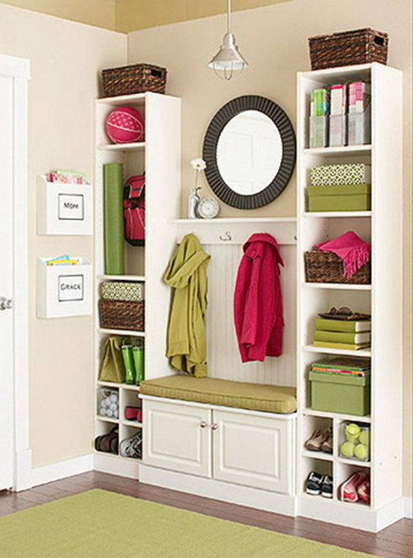 Create this mini mudroom from IKEA Billy Bookcases and a bit of beadboard and trim. It costs not much and looks like custom built-ins! A super inexpensive DIY project. Get more details