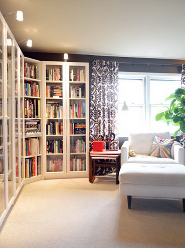 DIY BILLY Bookcases with Height Extensions and Glass Doors.