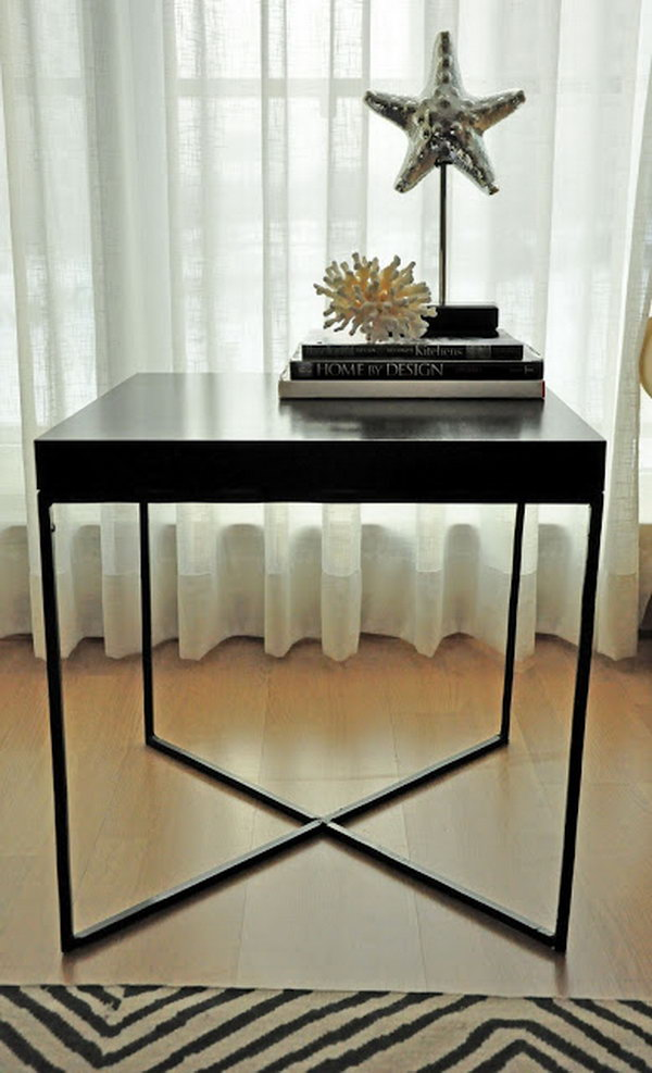 Modern Welded Table. This creative welded table is made with the wood tabletop from an IKEA LACK table and the X-shaped metal frame as the table legs. It's simply chic and perfect for any room of your house. See more details