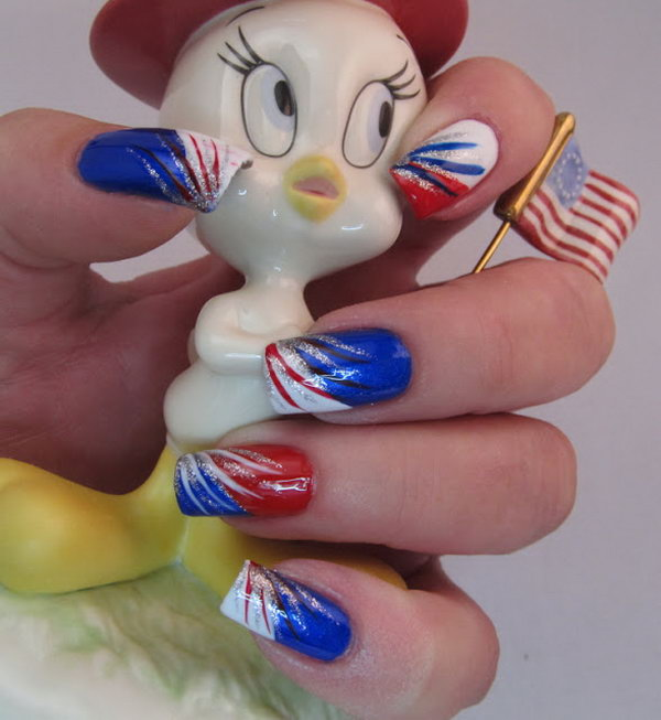Red, White, Blue and Silver Stripes: This one is very easy to re-create. Apply a color to each nail and then paint a diagonal tip on each one. Add red, white, blue and silver stripes with brushes and it's done. See the tutorial