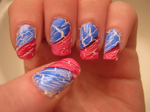 Quick and Easy Patriotic Nail: This 4th of July nail art is simpler than it seems. Red and blue texture polish, a white base coat, and a white nail art pen are all it takes to snag this fancy look. See the tutorial