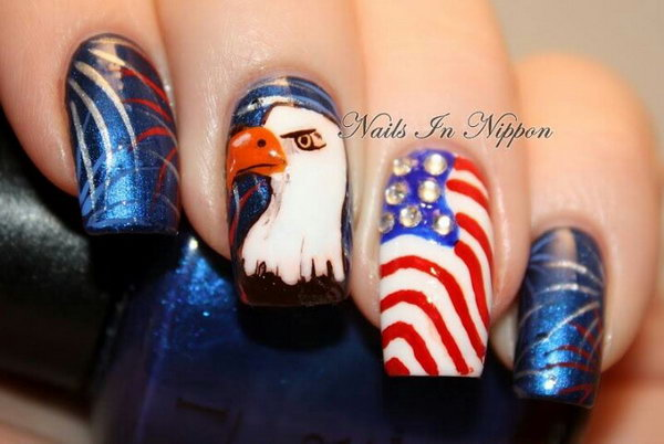 Cool and Glittery: Cool eagle, fireworks and stripes manicure with a glittery crystal accent nail. See how to here.