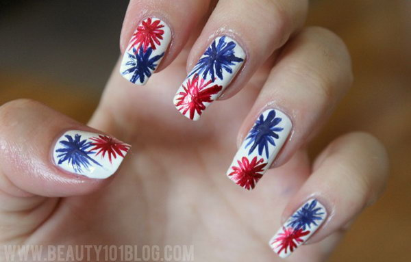"Patriotic Fireworks Long Nail Design: If you in love with watching the fireworks and you have long nails. This beautiful fireworks nail design is just for you. The fancy look is actually simpler than it seems. Use blue and red color to draw an ""X"" on the white base coat. Then keep adding to it until you get the firework as big as you want. Head over to the tutorial."