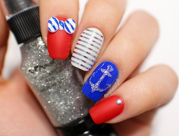 4th of July 3D Striped Bows Accented Nails:  This 3D striped bows design is a funny take on navy inspired nails. Start with blue, white and red alternating bases, then draw the silver anchor and clean stripes with nail art pens. Add a silver stud and the striped bows and it's done. See the tutorial