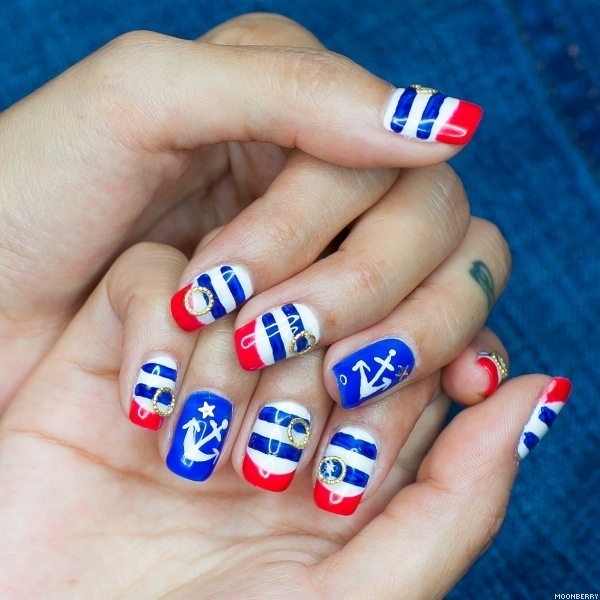 Patriotic Nautical Nail Art: The red blue and white stripes with an anchor accented nail design is so pretty. And the little golden rings added to the stripes plus a fancy look. Check out the tutorial