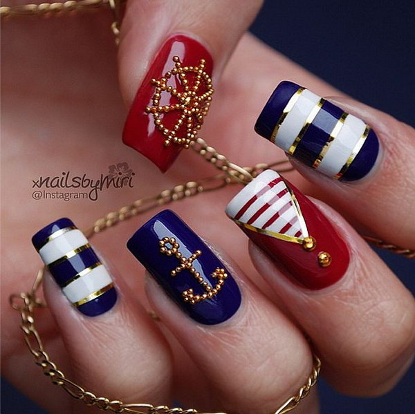 Patriotic Nautical Long Nails: With the meticulous anchor and wheel arrangements of those little gold beads, this manicure looks really luxury and fancy.