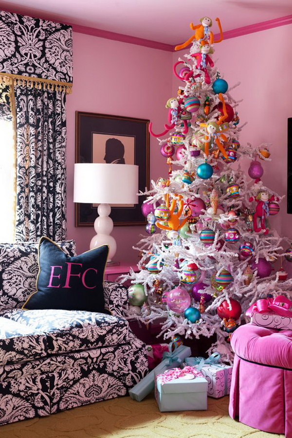 White Christmas Tree with Colorful Decorations. When considering which colour theme to use for your Christmas tree, look to your house's decorating style and colour.