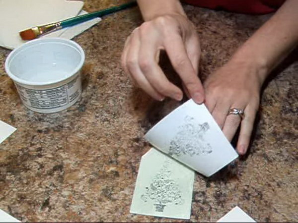 Create mixed media art using printed labels and cheap hairspray.