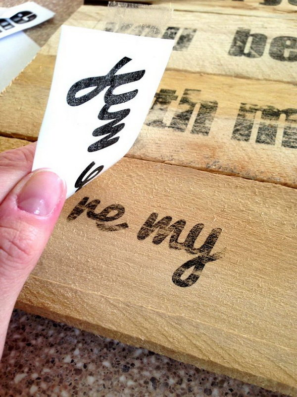 Easy way to transfer ink from paper onto wood for a homemade sign with freezer paper.