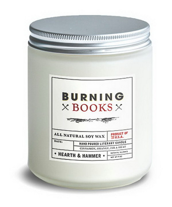 Burning Books Literary Candle. This scented candle reveals the scent of cinnamon, combined with orange and fir. It smells like you're sitting by a fire reading your favorite banned book.