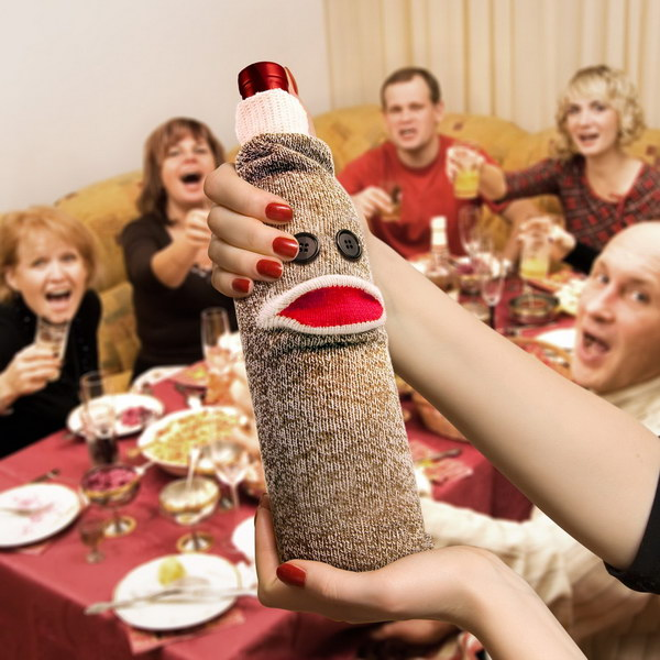 Fred & Friends Wine Monkey. Do you have memories of the handmade Sock Monkeys? This wine sock is such a cute way to present a wine gift and would be sure to make someone smile.