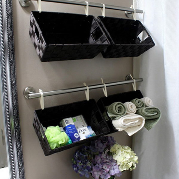 Baskets As Towel Holders. Super simple and cheap space saving idea!