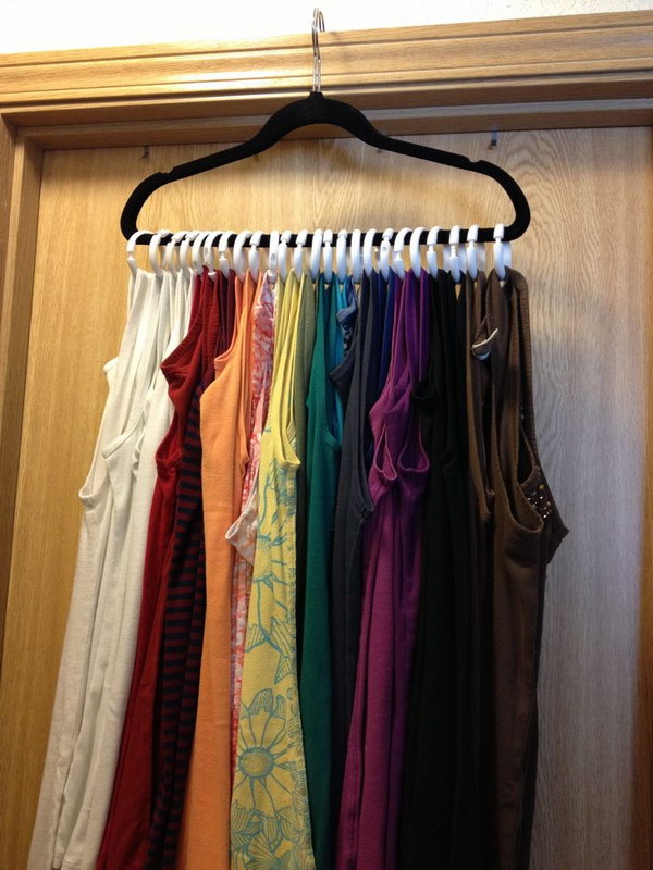 Tank Top Clothes Hanger. With just a few shower curtains rings and a velvet hanger, you can store those bad boys all on ONE hanger.