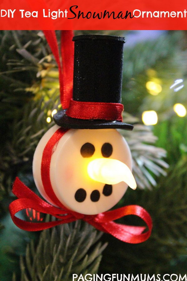 Tea Light Snowman Ornaments. What an easy but cute DIY Christmas craft idea for the frugal gift givers. Send your neighbors little tea light snowman ornaments to hang on their Christmas trees.