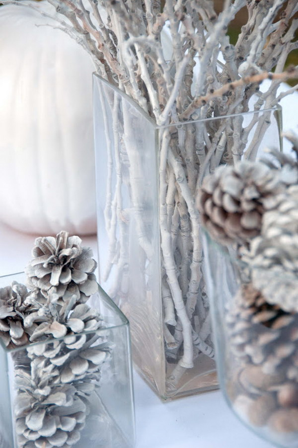 Bleached Pine Cone Tablescape. Love the way these ordinary and natural pine cones and branches look like. Super awesome and inexpensive winter table decor.