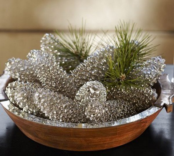 Mercury Glass Look Spray Paint Pinecones. Get a winter look with these mercury glass painted pine cones.