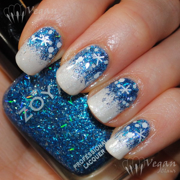 Blue Glitter Snowflake On White Gel Nails
