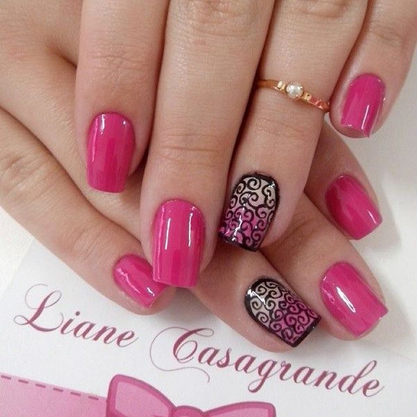pretty pink nail design with black polish swirl designs