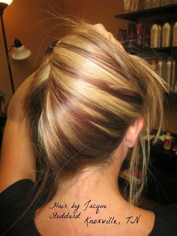Sleek Blonde Hair with a Little Red Highlights.