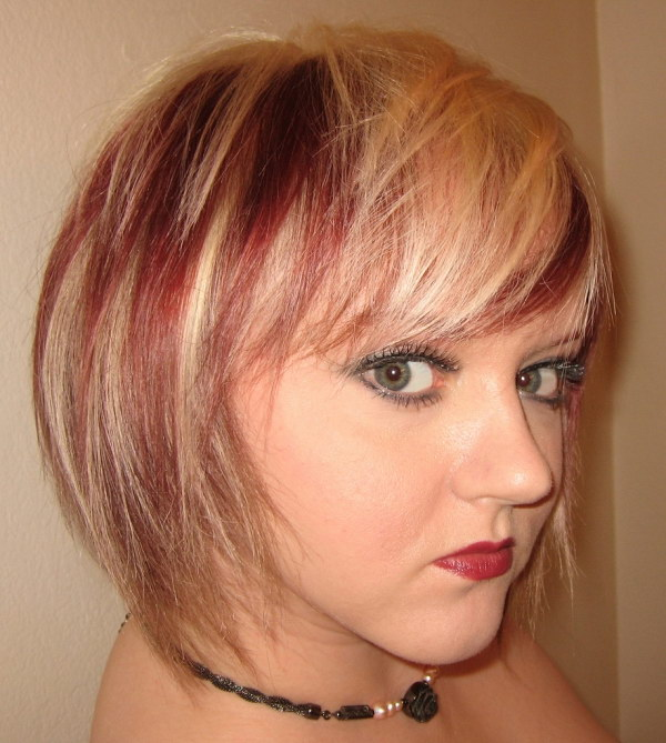 Red Highlights within Blonde Hair.