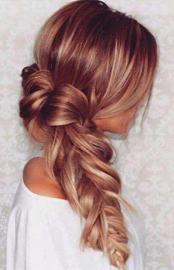 Messy Blonde Fishtail Braid with Red Highlights.