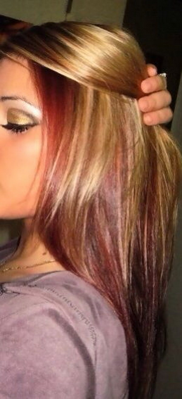 Sleek Blonde Hair With Red Highlights.