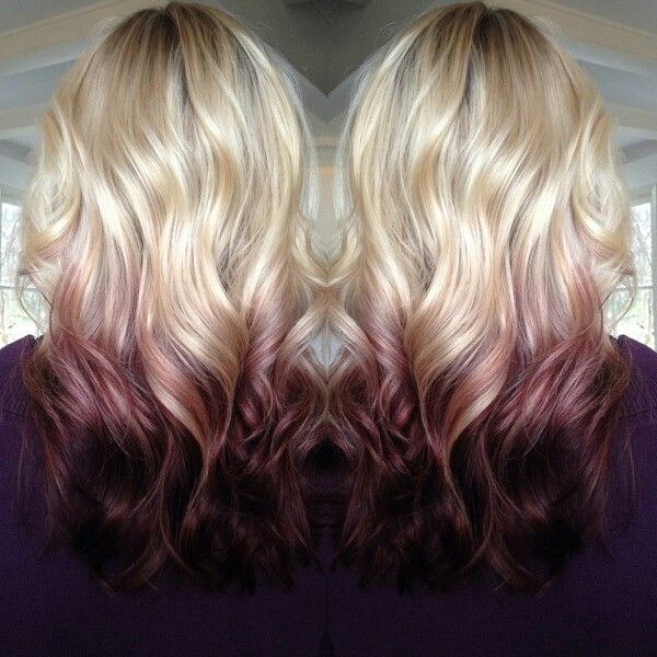 Blond Wavy Hairstyle with Red Highlights.