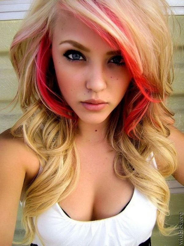 Blond Wavy Hair with Red Highlights.