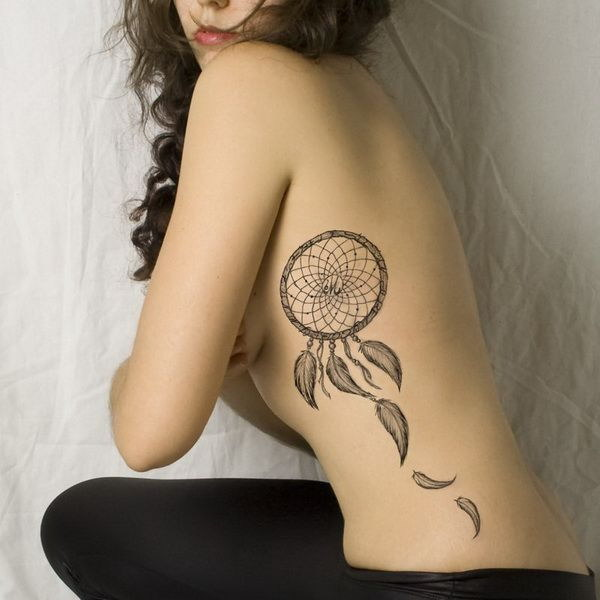 Dream Catcher Tattoo on Side.