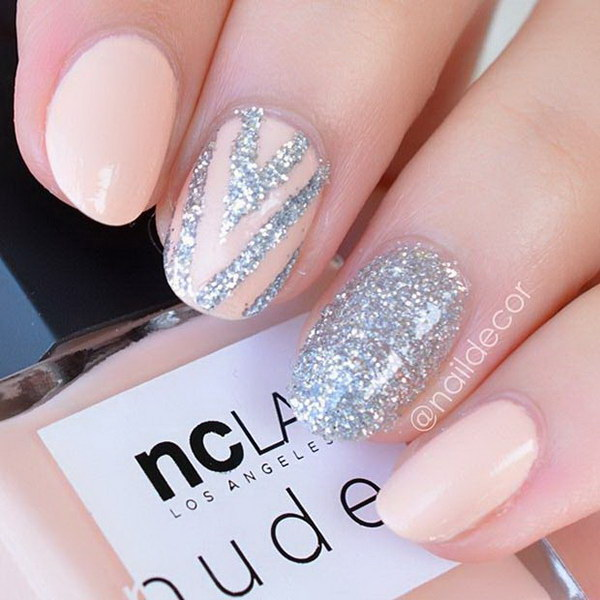 Nude Nails Accented with Patterns, Graphics and Glitter.