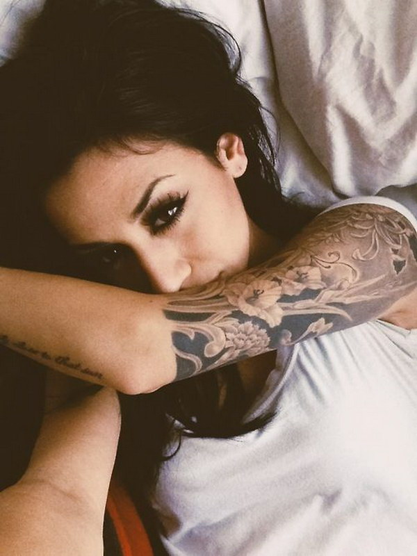 Nice Half Sleeve Tattoo in Black and Grey.