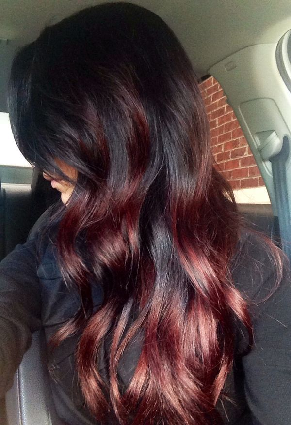 Vintage Styled Red Highlighted Long Black Wavy Hairstyle.