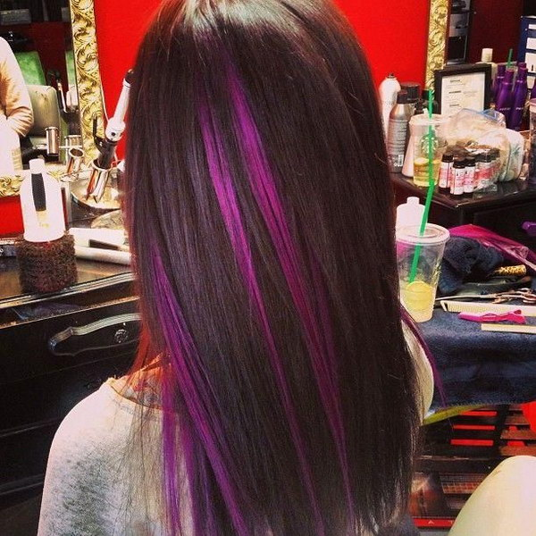 Straight Black Hair with Purple Highlights.