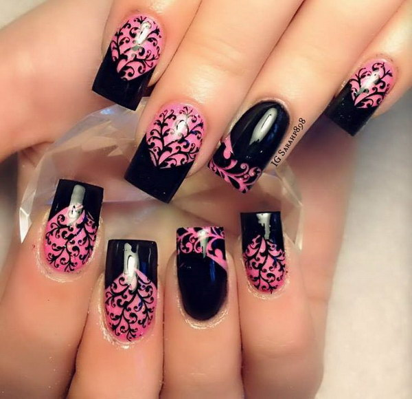Black Chevron Tips and Intricate Floral Details over Pink Base Nails.